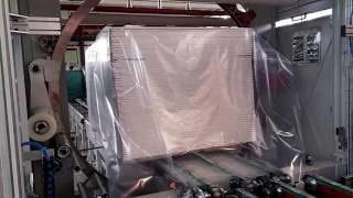 Упаковка панелей в стретч на машине AREA210